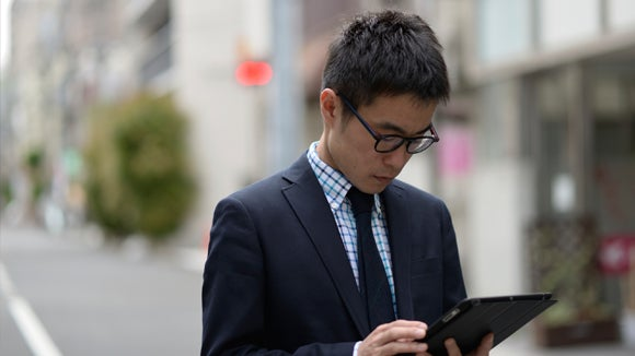 asian-male-on-cellphone