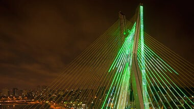 Cable stayed bridge with green color lights at night