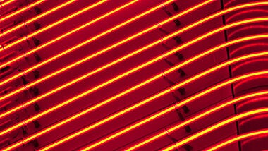 Layers of neon light tubes in red orange lights