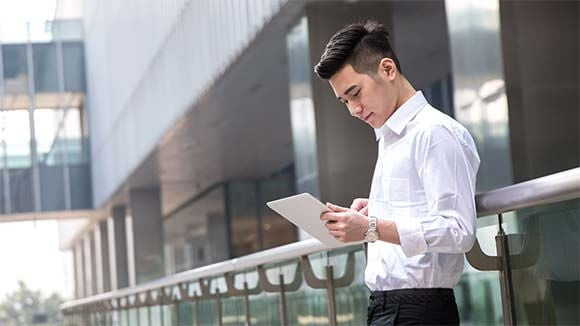 Asian businessman using a tablet